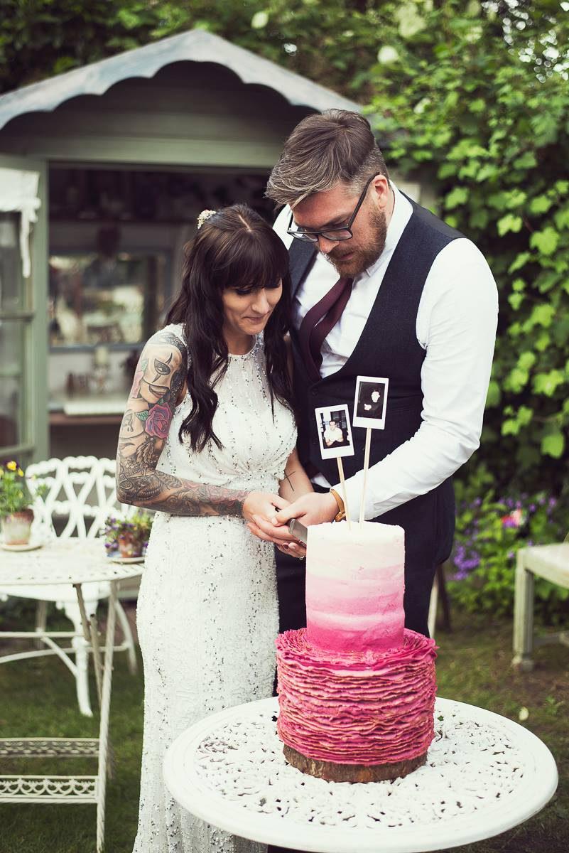 tattooed bride pink wedding cake