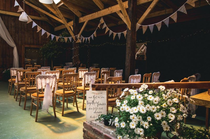 Barn decorated with bunting and flowers