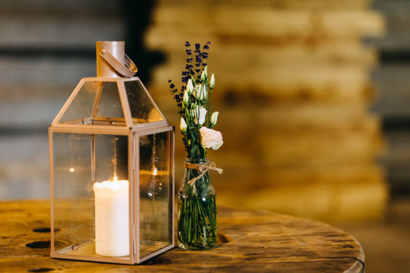 candle and simple floral table centrepiece