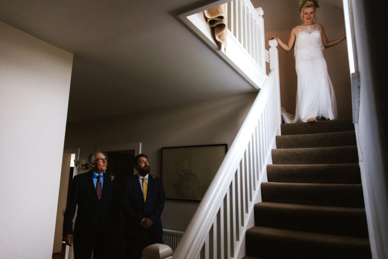 Bride walking down stairs to her Dad
