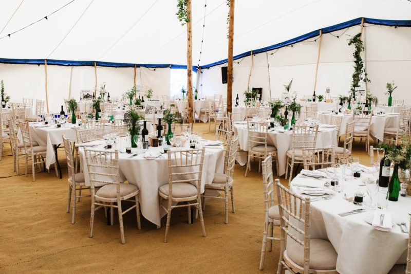 Festival wedding white and green decor in marque