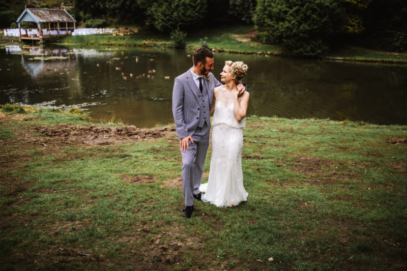 Alternative bride and groom by a lake