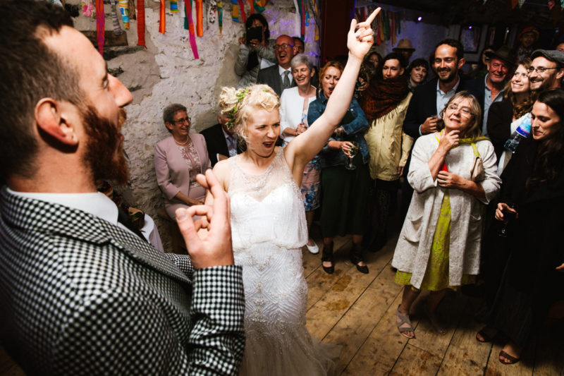 Bride dancing at festival wedding