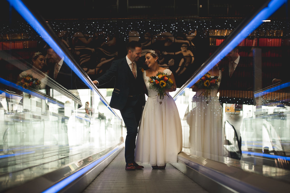 Birmingham library bride and groom on escalator