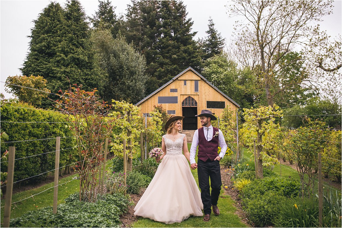 Stanton Hall and Gardens bride and groom with cowboy hats