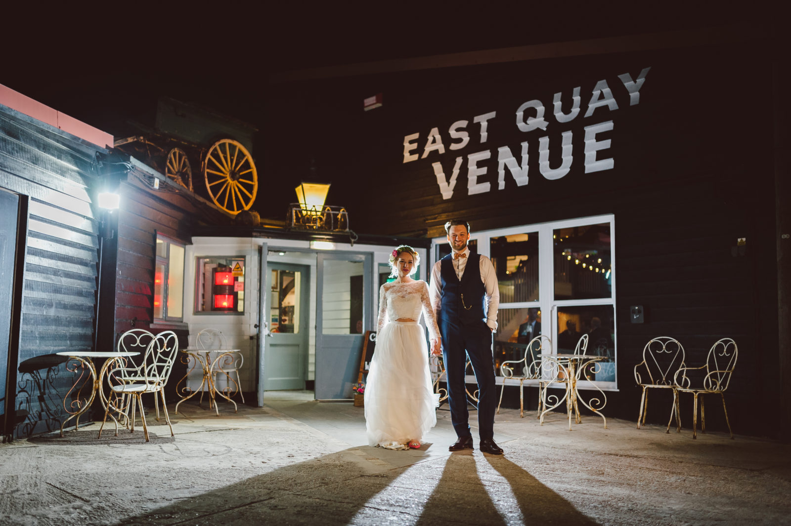 East Quay Venue at night with cool bride and groom