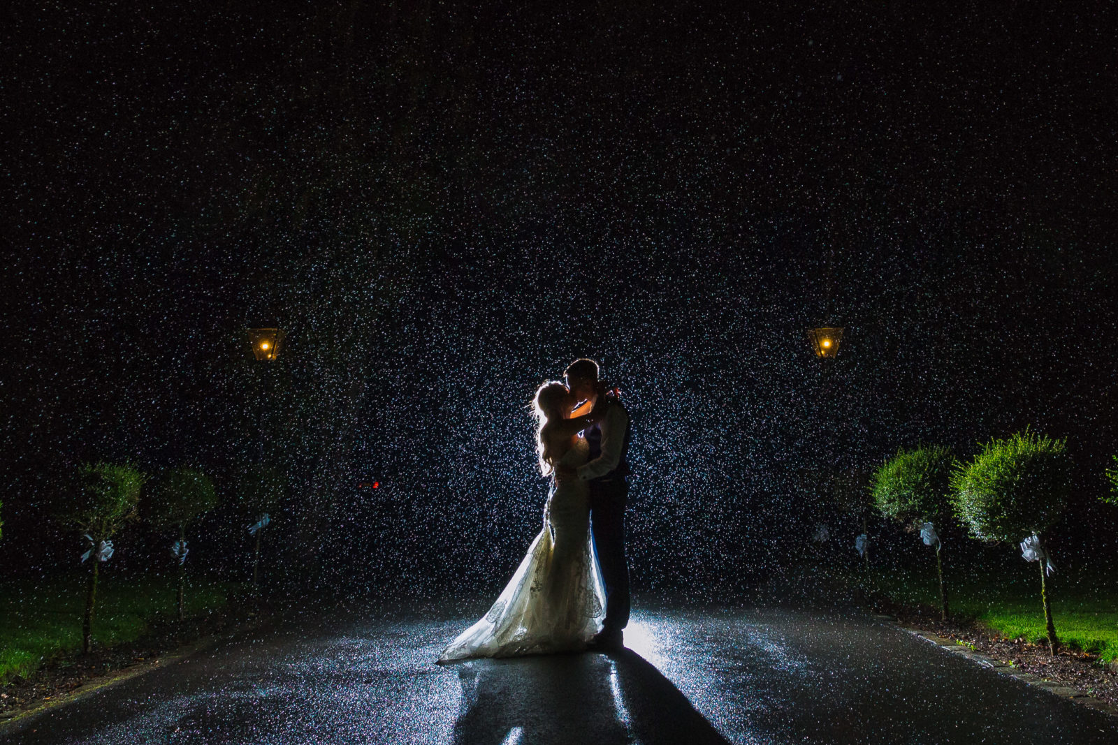 Bride and groom dancing in the rain make your wedding day go smoothly
