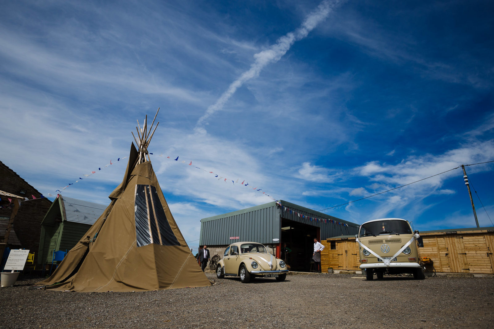 Tipi and beetle car and campervan at Wellbeing Farm