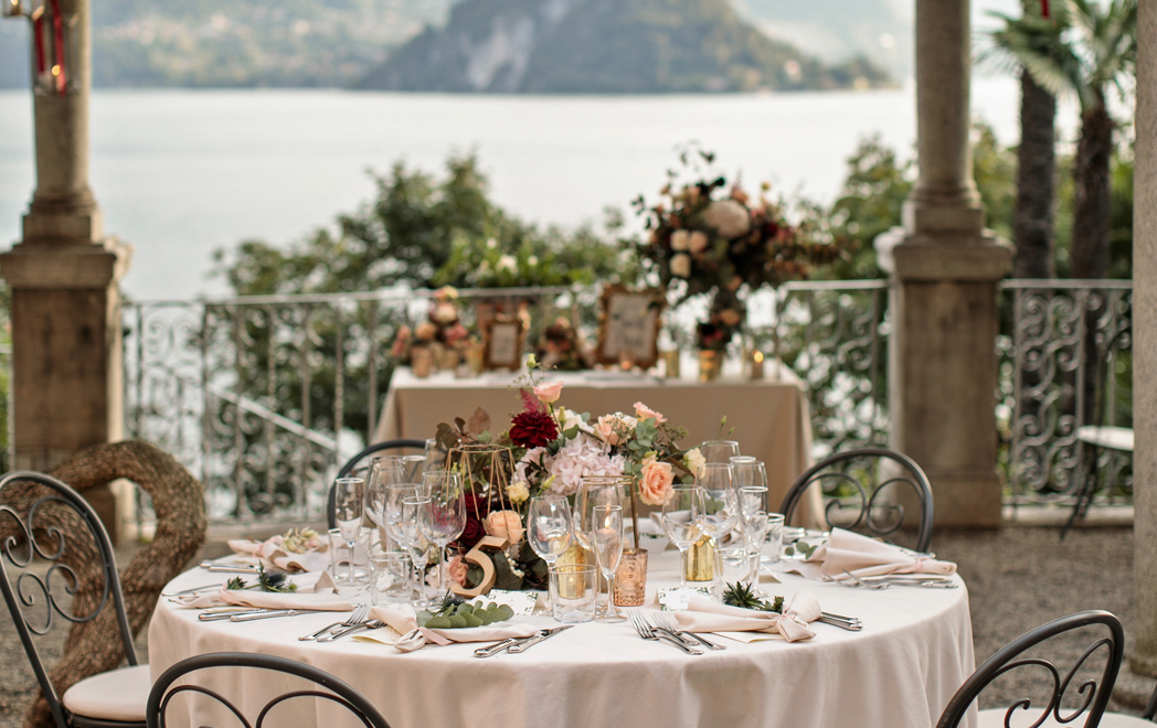 Tables decorated with roses by Lake Como wedding planner Gemma Aurelius