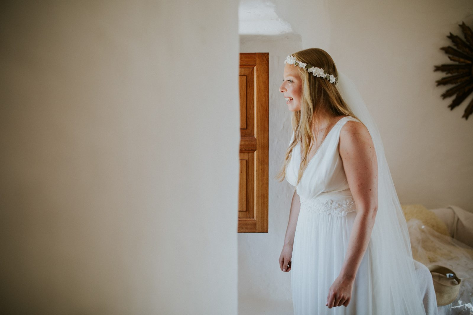 Bride looking out of window - getting married in Mallorca on a budget