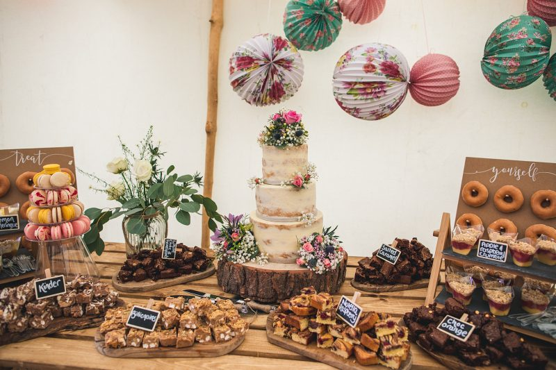 wedding reception ideas Wedding dessert table brownies wedding cake blondies flowers paper lanterns Andy Hudson Photography