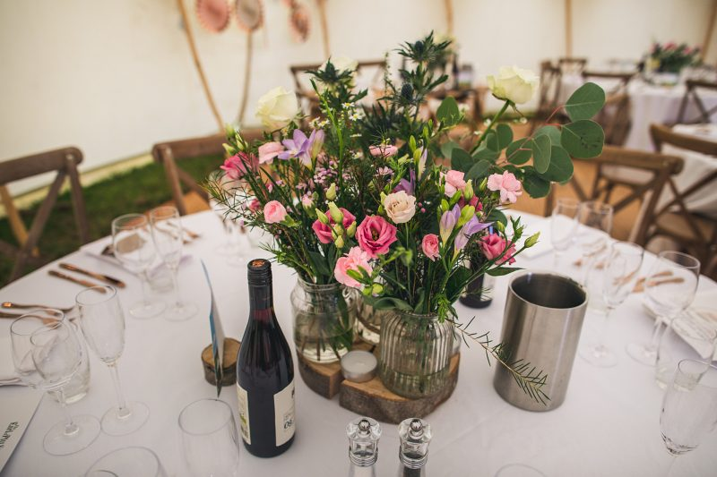 wedding-reception-ideas-Tabel-centrepiece-flowers-jam-jars-rustic