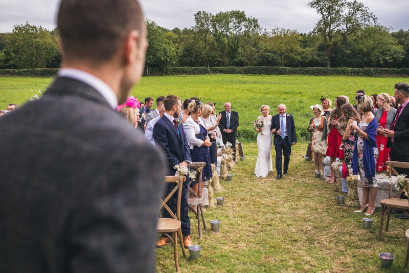 Bride walking down aisle outdoor wedding Northumblerland
