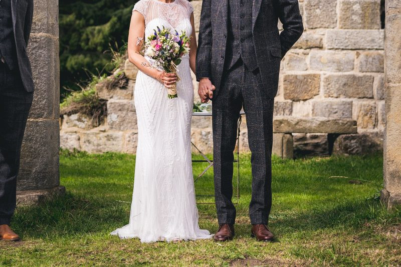 Beaded wedding dress YAP newcastle wild flower bouquet three piece wedding suit Walker Slater Andy Hudson Photography