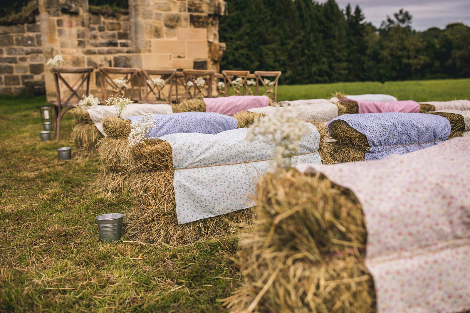 Fabric covered haybales outdoor wedding Newcastle Andy Hudson Photography