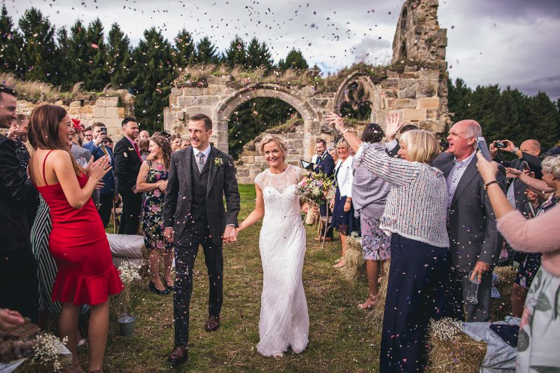 Bride groom confetti ruined Abbey outdoor ceremony Andy Hudson Photography