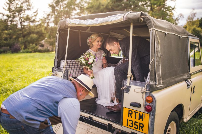 Bride and groom in wedding Landrover outdoor boho wedding Andy Hudson Photography