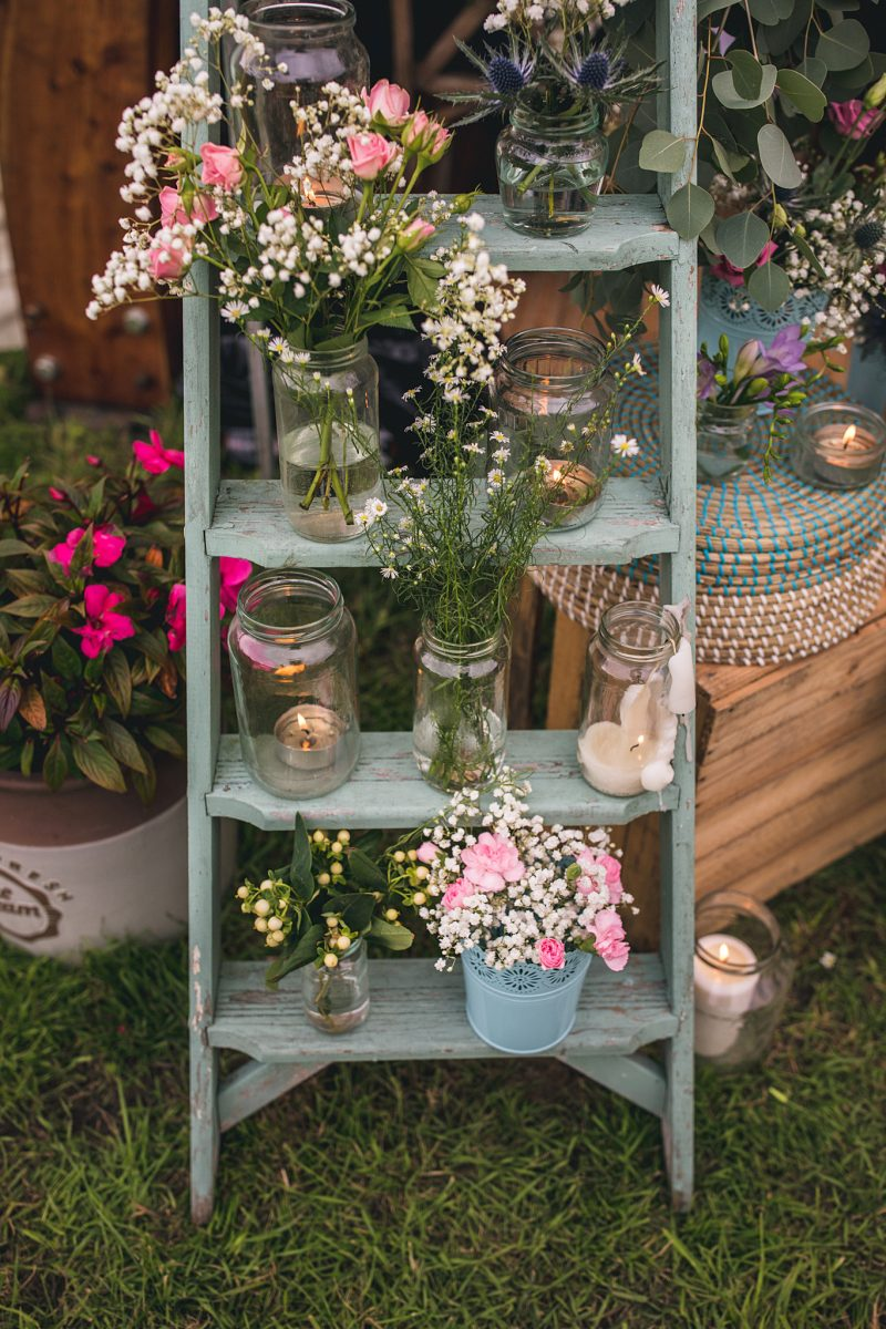 wedding reception ideas Wedding decor ladder jam jars flowers gypsophila roses carnations candles rustic boho