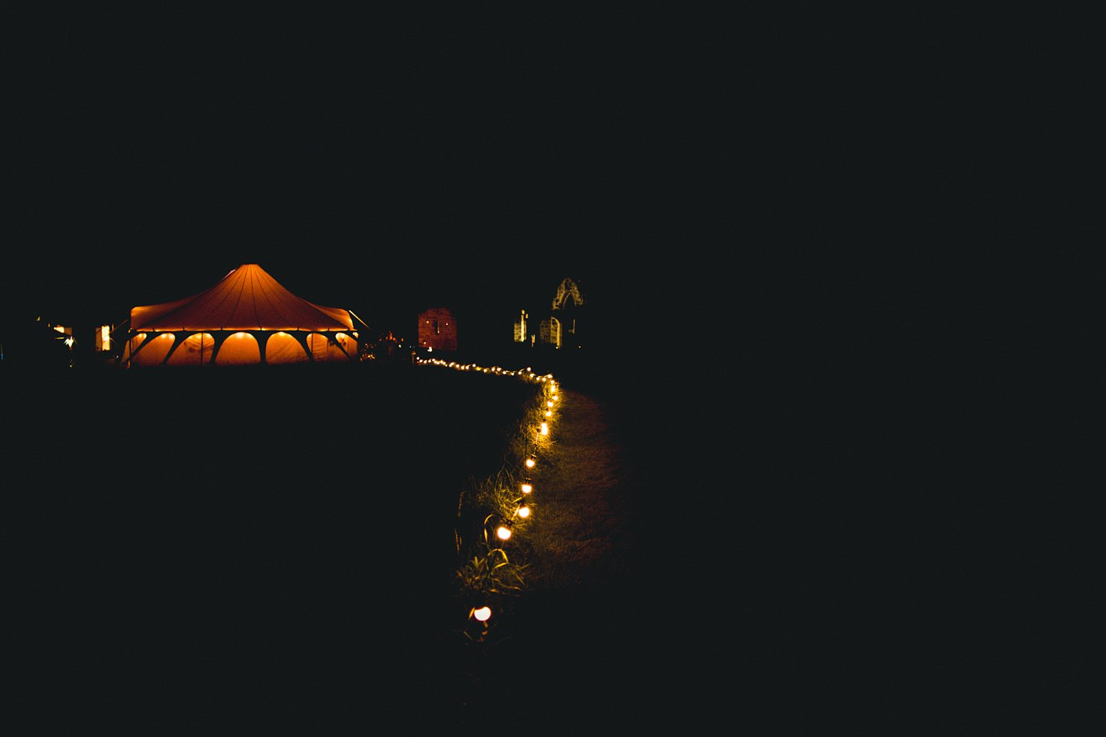 Curious Tent Hire bell tent at night