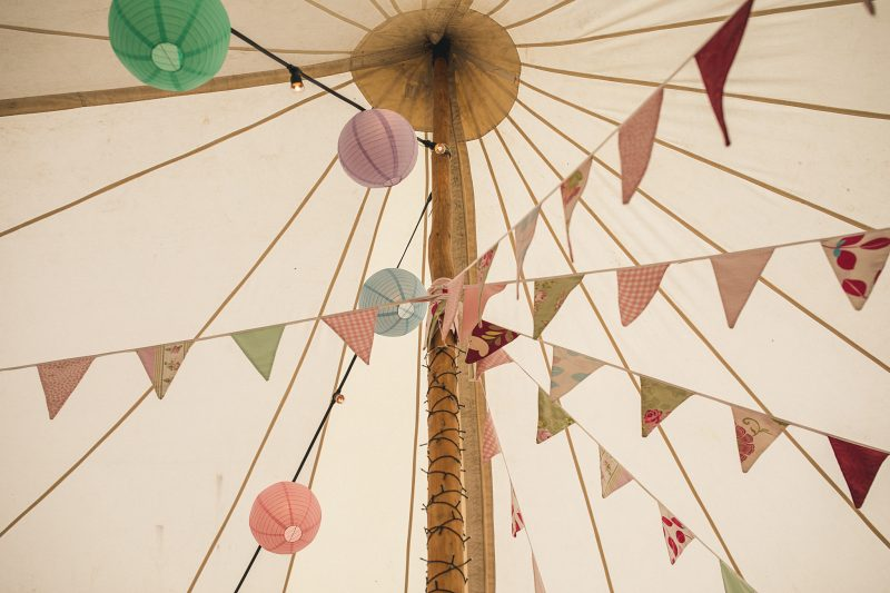 Pastel bunting in wedding tent