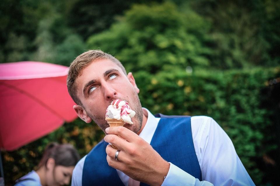 wedding guest eating icecream