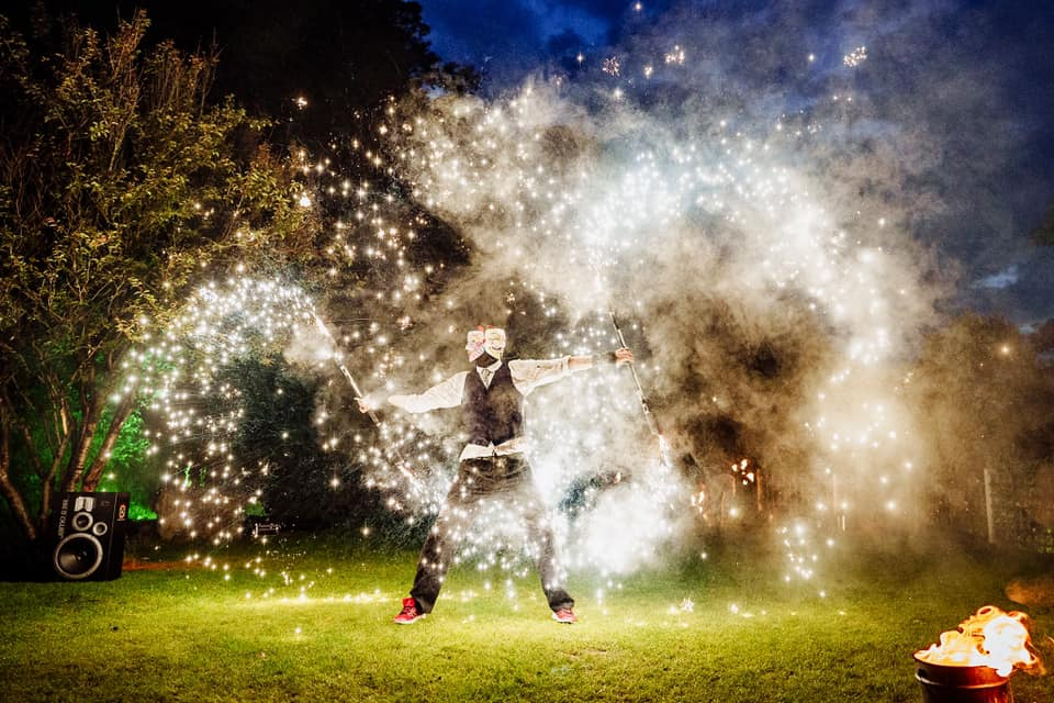 fire juggler at wedding