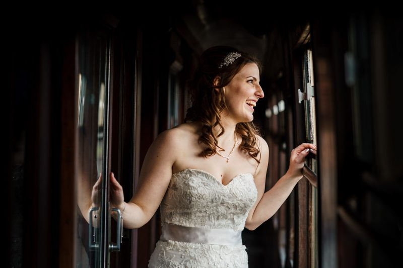 smiling-bride-on-train