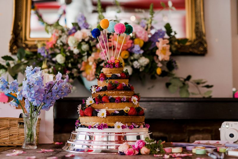Naked cake wedding colourful pompoms