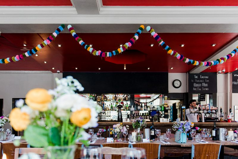 Colourful London pub wedding pompom garlands
