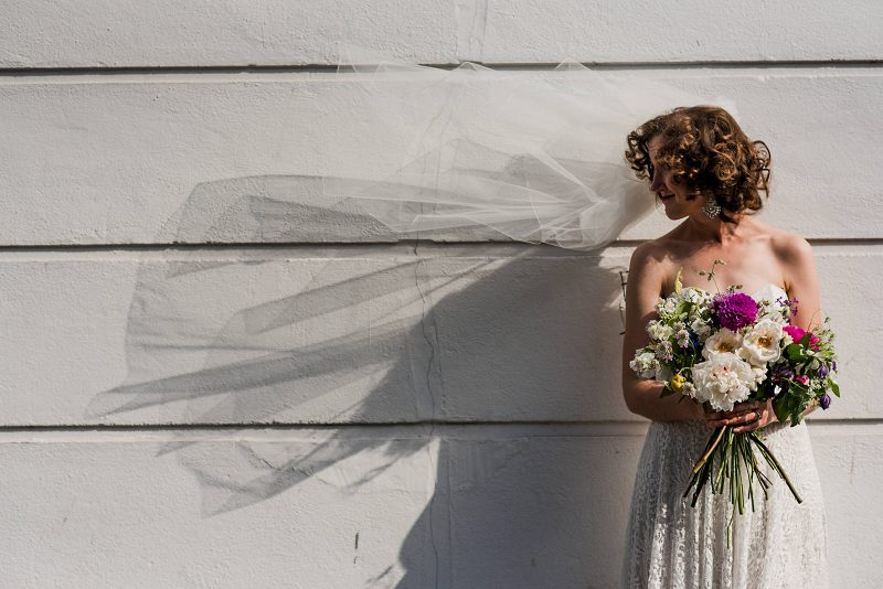 Bride strapless dress veil wild flowers