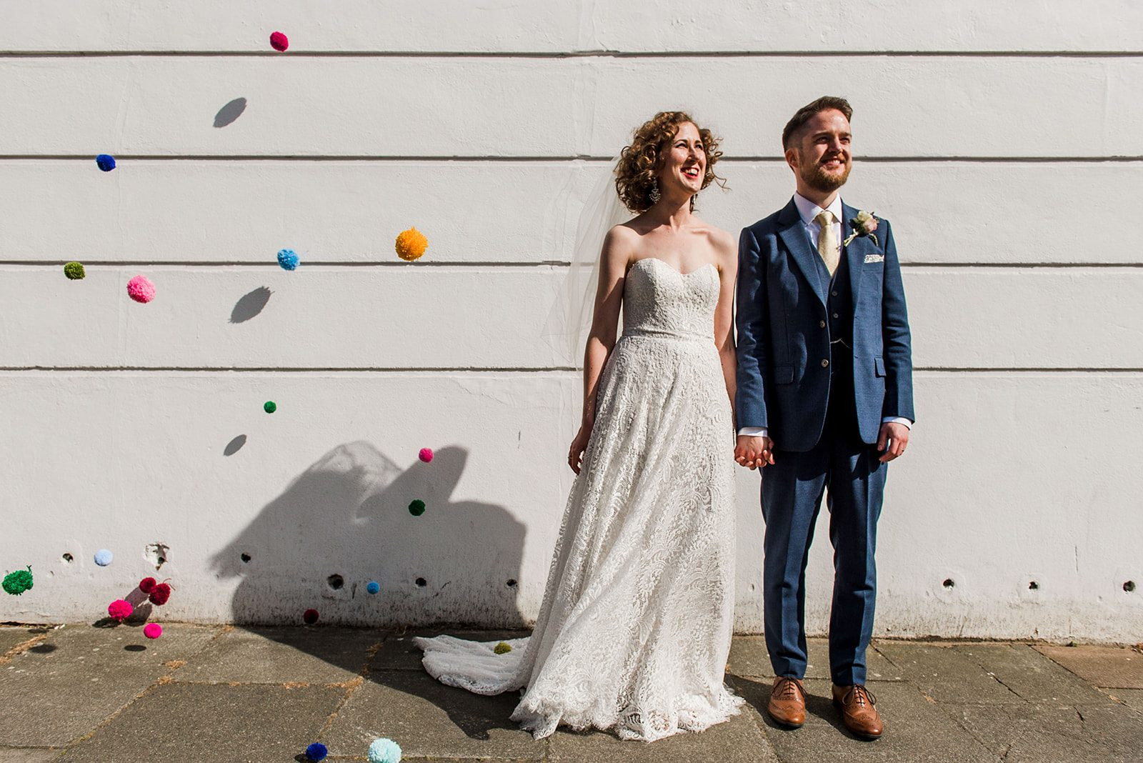 Colourful London pub wedding bride groom pompoms