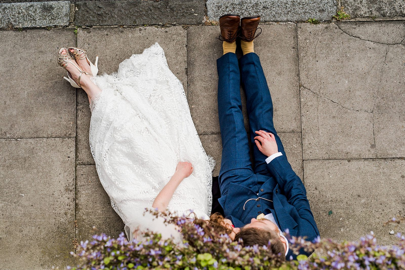Bride groom sitting down wedding shoes