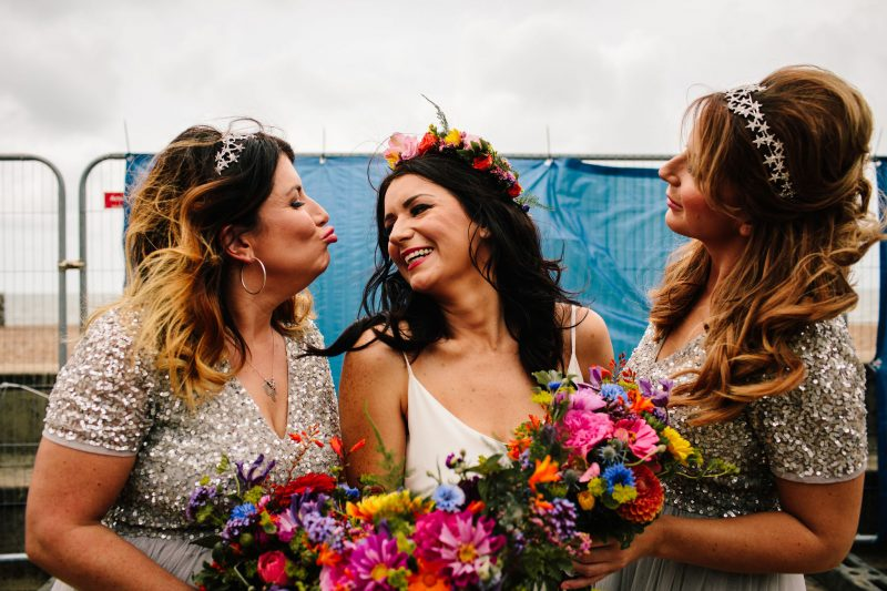 bride bridesmaids colourful bouquets