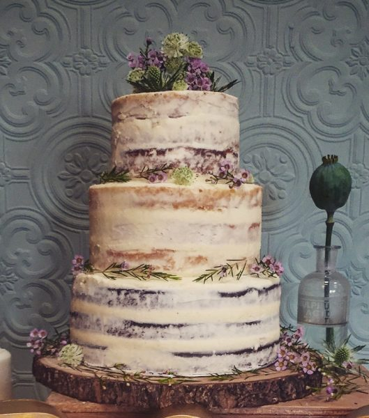 semi naked cake purple flowers