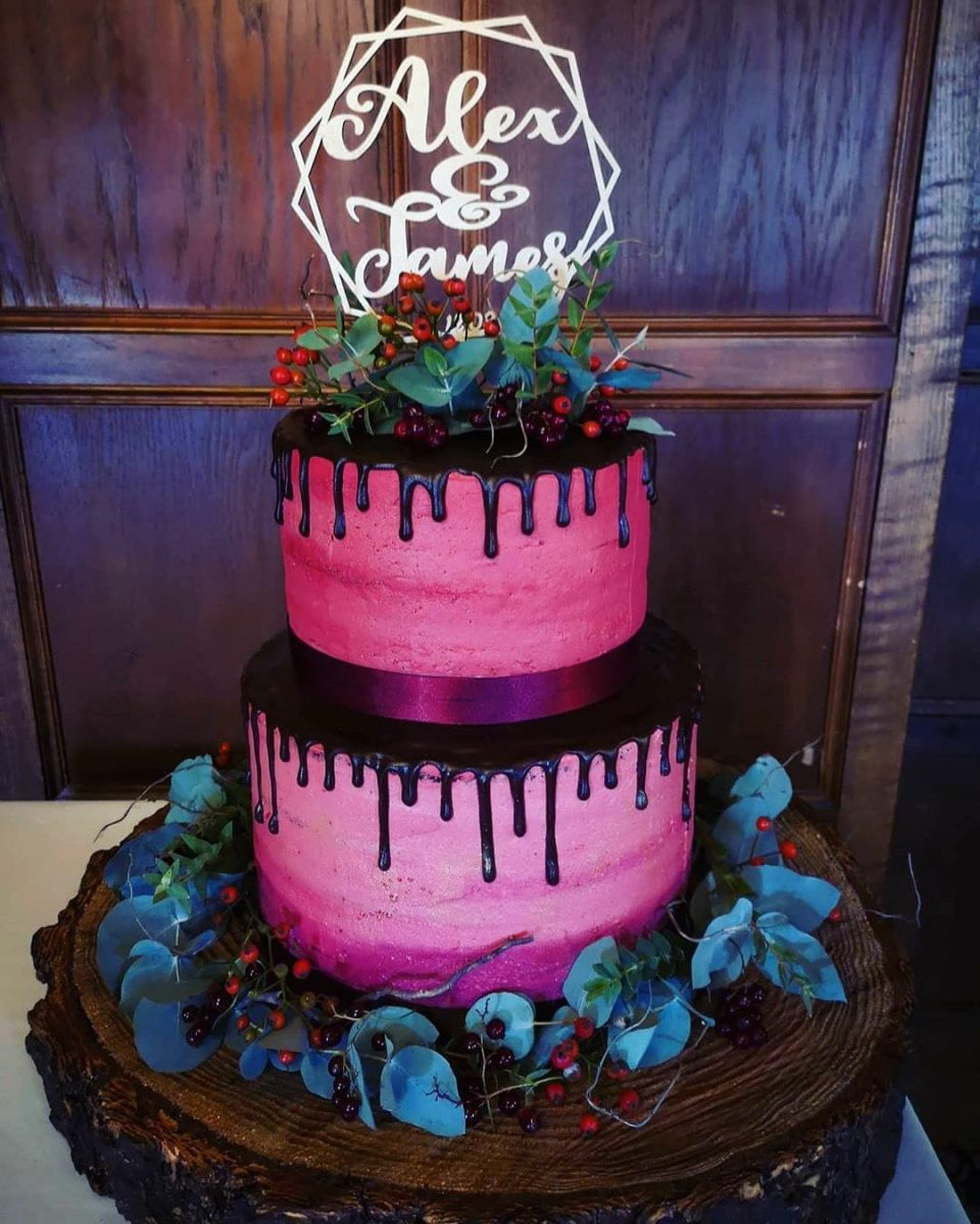 pink and black drip cake