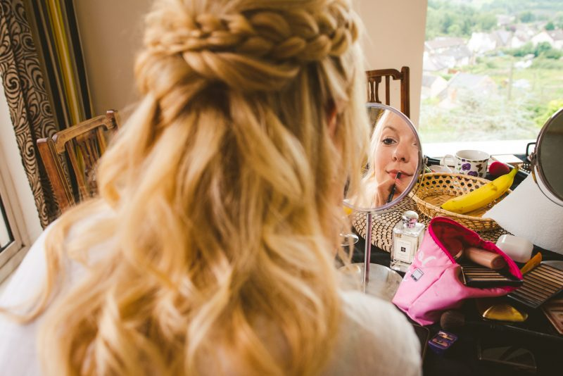 Bride getting ready wedding hair plaits braids