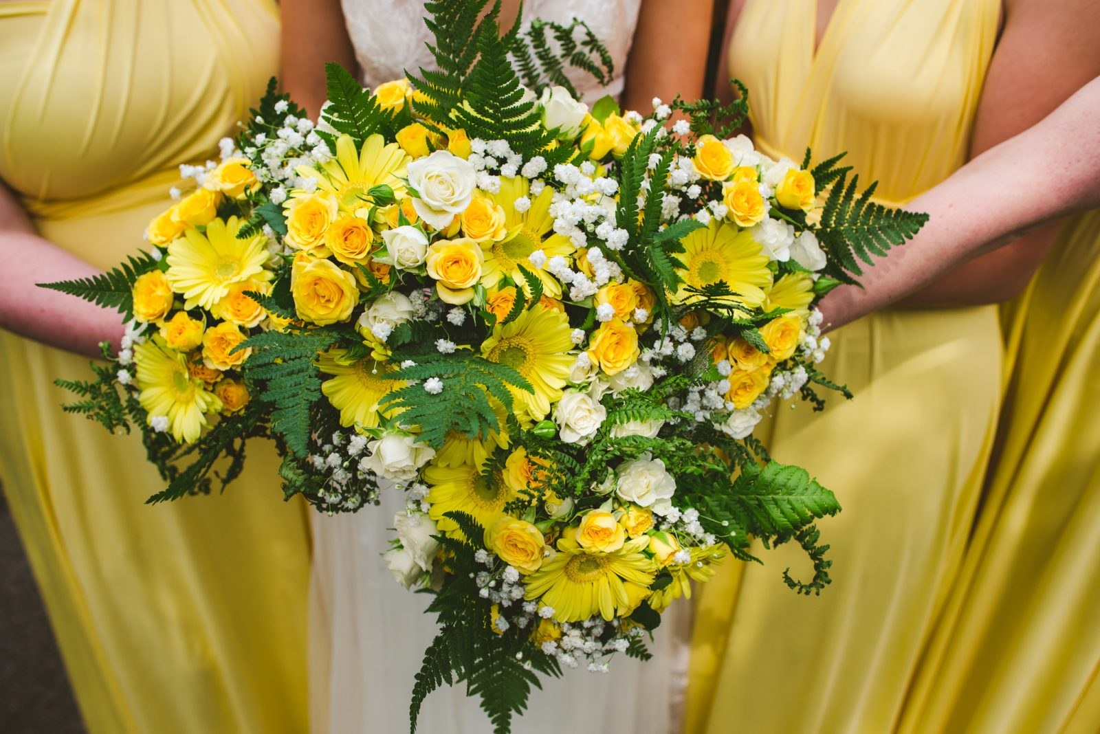 Yellow white bouquets bride bridesmaids