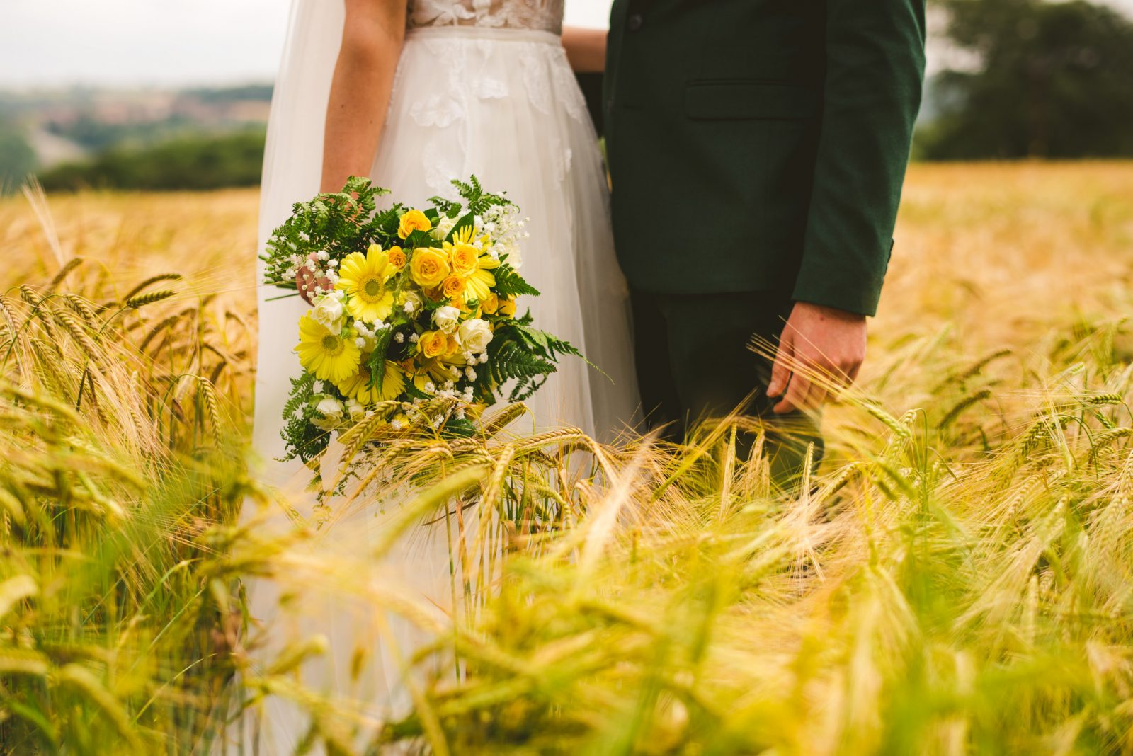 Yellow wedding flowers bride groom field