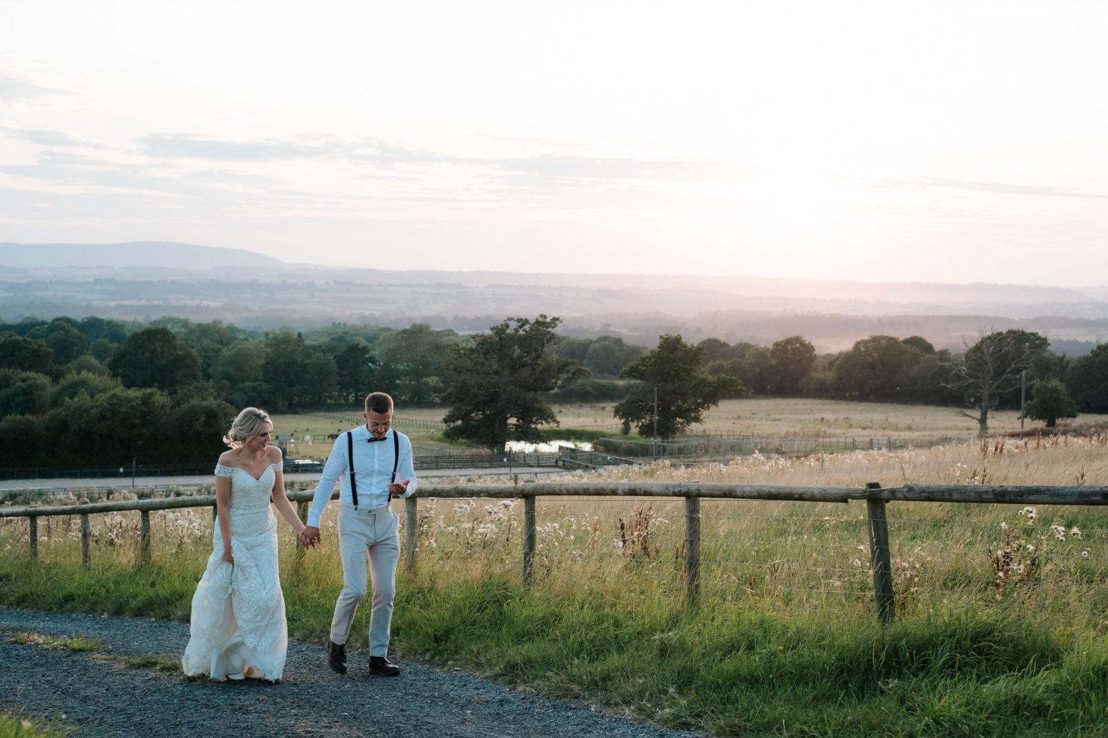 bride groom walking fields sunset shropshire