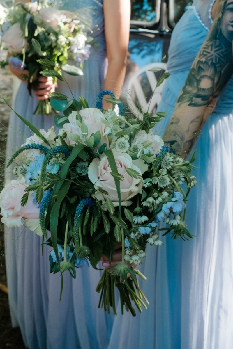 wedding flowers pale pink light blue trailing foliage