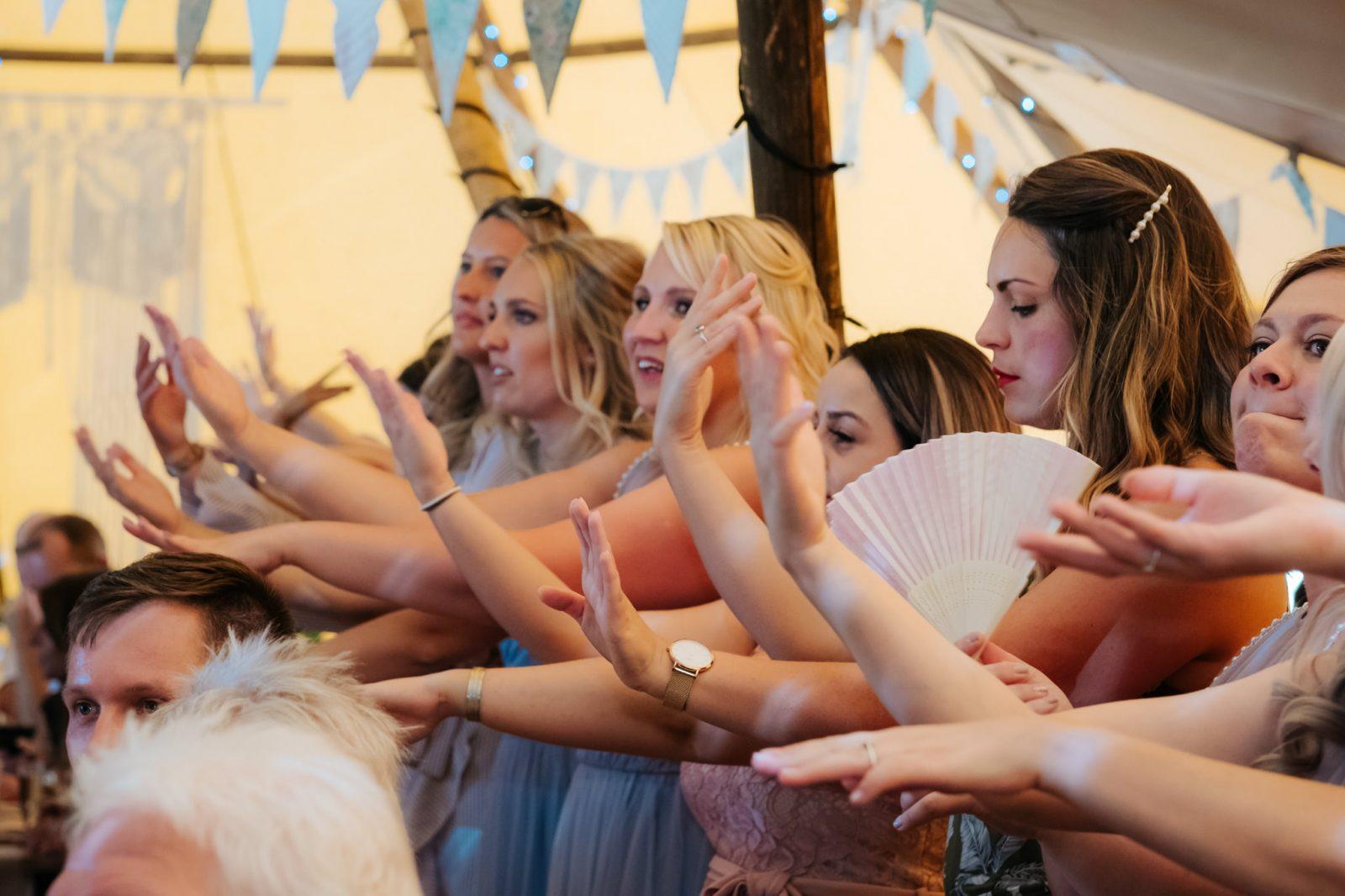 wedding guests dancing macarena