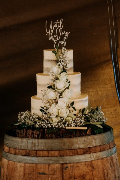 semi naked wedding cake white flowers