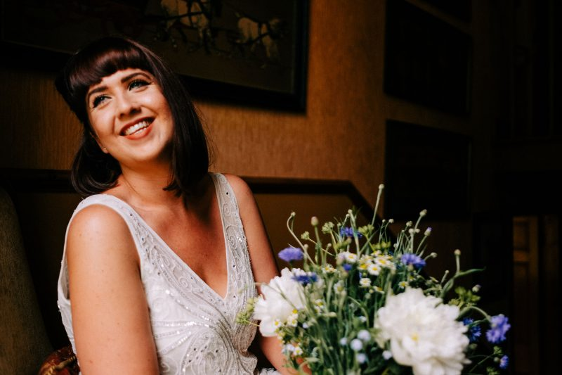 Beaded Phase Eight wedding dress smiling bride