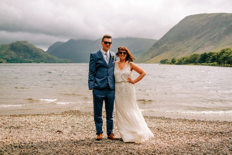 bride and groom on beach Lake District