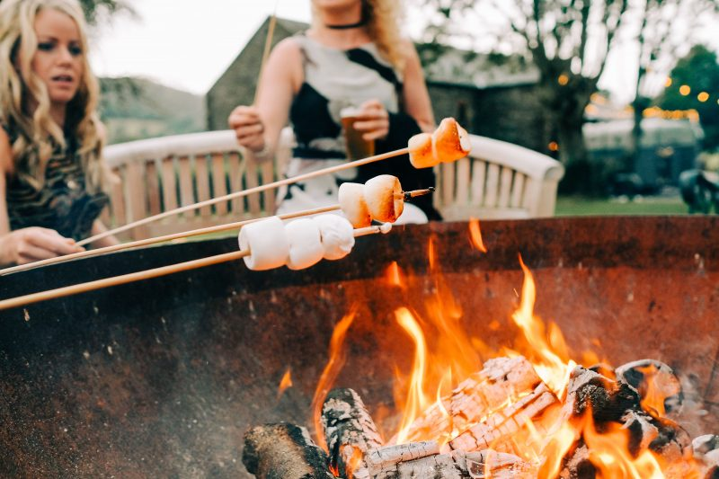 toasting marshmallow barn wedding